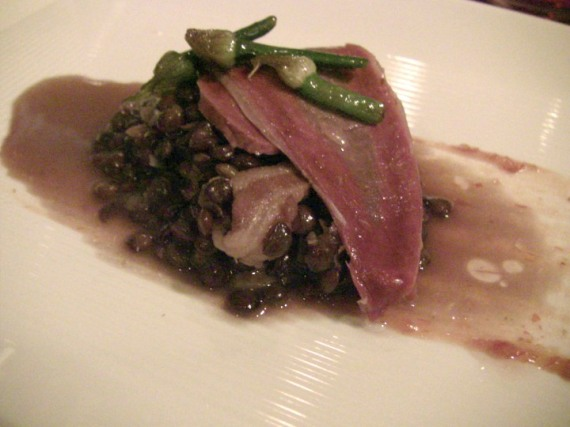 Beef Heart Confit over Hobbs' Bacon, Lentils, Onion Flowers